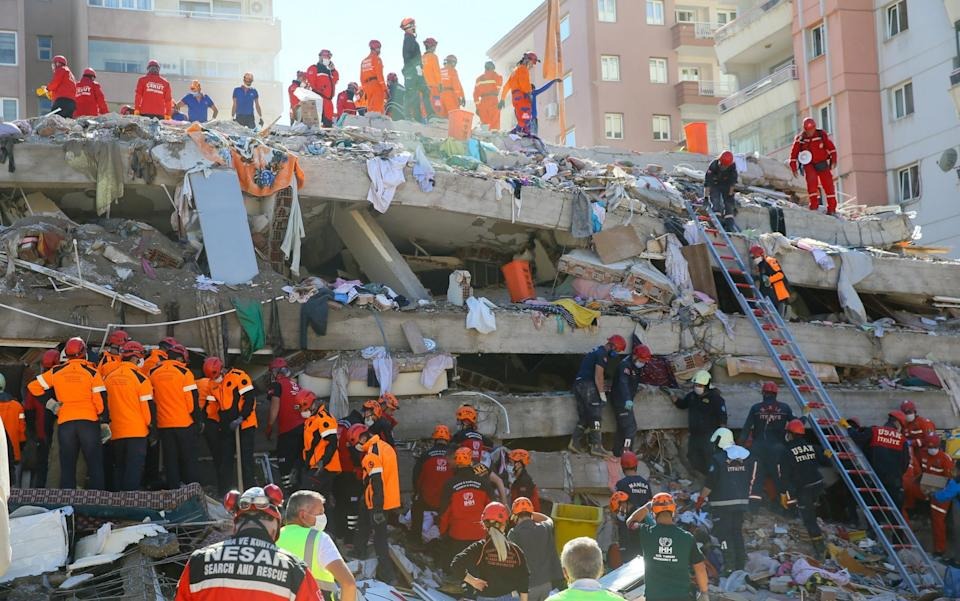 Search and rescue works continue at the rubbles of collapsed Riza Bey building located in Bayrakli district  - Anadolu