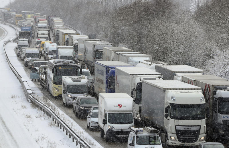 Stationary traffic stands on the M20 near Ashford, Kent, southeast England following overnight snowfall which has caused disruption across Britain. Tuesday Feb. 27, 2018. Roads across Britain have already seen a good covering snow, with police forces reporting treacherous driving conditions and blocked routes. (Gareth Fuller/PA via AP)