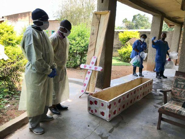 PHOTO: Health workers at Mangina hospital prepare to conduct a safe burial, Aug. 15, 2018. (Nyka Alexander/WHO)
