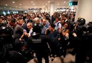Protesters demonstrate at the airport, after a verdict in a trial over a banned independence referendum, in Barcelona