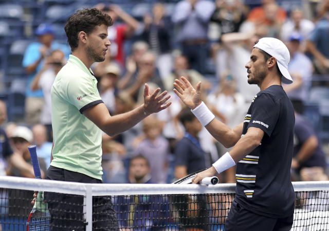 Dominic Thiem, of Austria, left, congratulates Thomas Fabbiano, of Italy, after Fabbiano won their first-round match of the US Open tennis tournament Tuesday, Aug. 27, 2019, in New York. (AP Photo/Michael Owens)