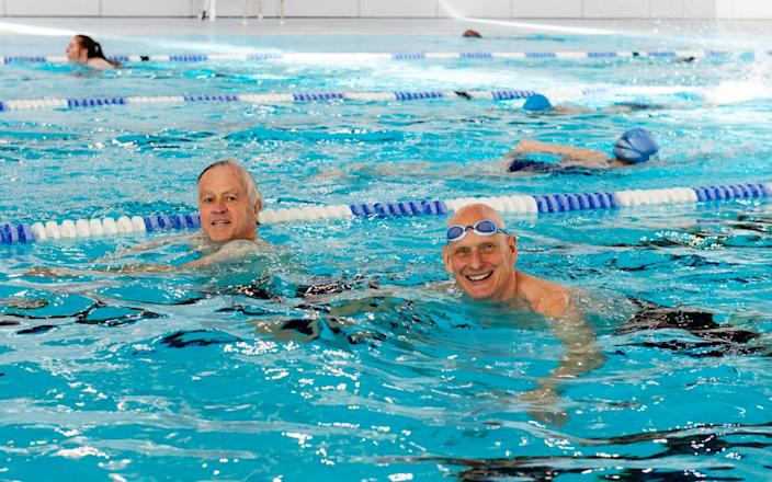 The Telegraph's Jim White swimming with Olympian, Duncan Goodhew on the first day of reopening of indoor swimming facilities, at the Clissold Leisure Centre, Stoke Newington, London. - Geoff Pugh for the Telegraph