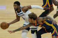 Golden State Warriors guard Kelly Oubre Jr., bottom, reaches for the ball next to Minnesota Timberwolves guard Malik Beasley during the first half of an NBA basketball game in San Francisco, Monday, Jan. 25, 2021. (AP Photo/Jeff Chiu)