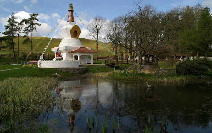 A recently-completed stupa dominates the gardens at the Samye Ling complex in Dumfriesshire - Colin McPherson/Corbis Historical