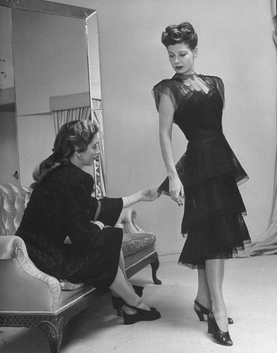<p>Miss America in 1939, Pat Donnelly, is seen here modeling a tulle black evening gown with a tiered skirt. Her perfectly curled up-do only adds to the polished look. </p>