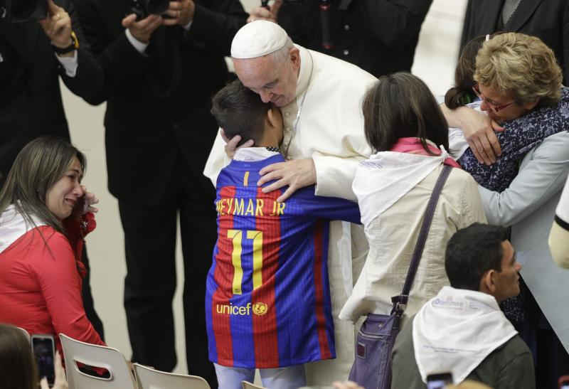 Pope Francis hugs a boy during an audience with Huntington's disease families, in the Paul VI Hall, at the Vatican, Thursday, May 18, 2017. Francis is trying to end the stigma of people afflicted with Huntington's Disease, an incurable genetic brain disorder that causes such serious involuntary movements and psychiatric problems that sufferers are often shunned and isolated. (AP Photo/Andrew Medichini)