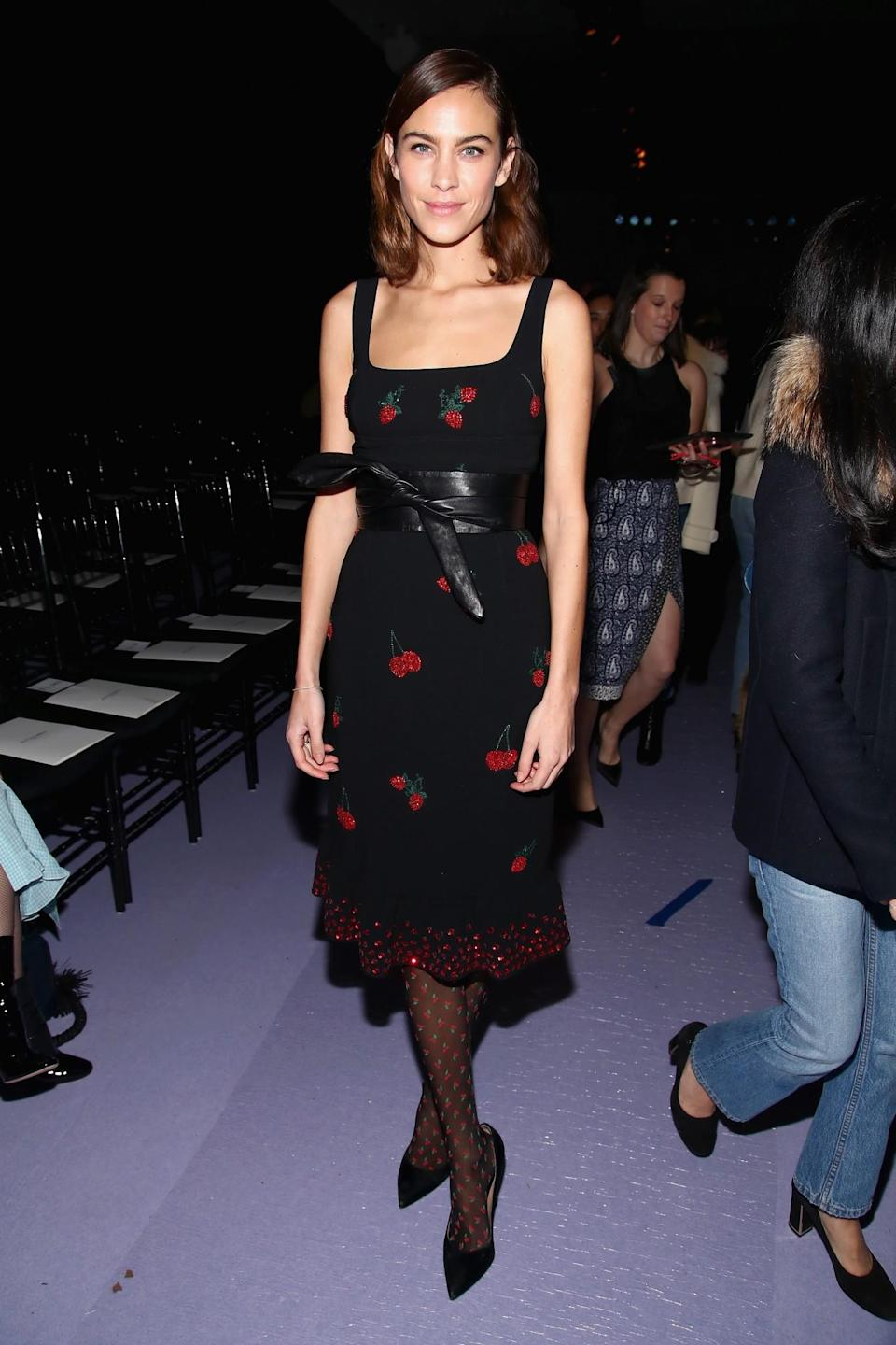 <p>Alexa Chung appeared in a cherry-printed dress with matching tights. <i>[Photo: Getty]</i> </p>