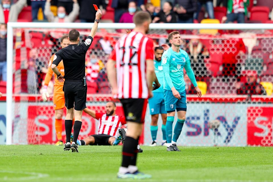 Mepham is shown a straight red card for a foul on MbuemoGetty Images