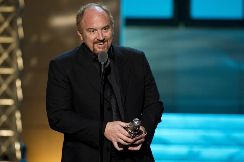"FILE - In this April 28, 2012 photo, comedian Louis C.K. appears onstage at The 2012 Comedy Awards in New York. When Louis C.K. released his comedy special ""Live at the Beacon Theater"" by himself on his website for $5, it was little more than a cautiously optimistic experiment. Less than two weeks later, it had reaped more than $1 million. Already among the most respected stand-ups in the country, Louis C.K. was suddenly a new media trailblazer, too. On Tuesday, the Webby Awards announced Louis C.K. is their ""person of the year"" for setting ""a new precedent for distribution."" Comedians Aziz Ansari and Jim Gaffigan have since similarly released albums online. (AP Photo/Charles Sykes, file)"