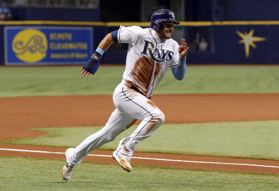 Tampa Bay Rays' Kevin Kiermaier rounds third base on his way to scorin during the first inning of the team's baseball game against the Miami Marlins on Friday, July 20, 2018, in St. Petersburg, Fla. (AP Photo/Mike Carlson)