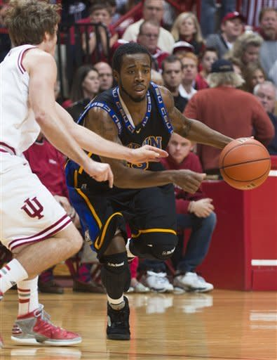 Coppin State's Troy Franklin drives the ball into the Indiana defense during the first half of an NCAA college basketball game Saturday, Dec. 1, 2012, in Bloomington, Ind. (AP Photo/Doug McSchooler)