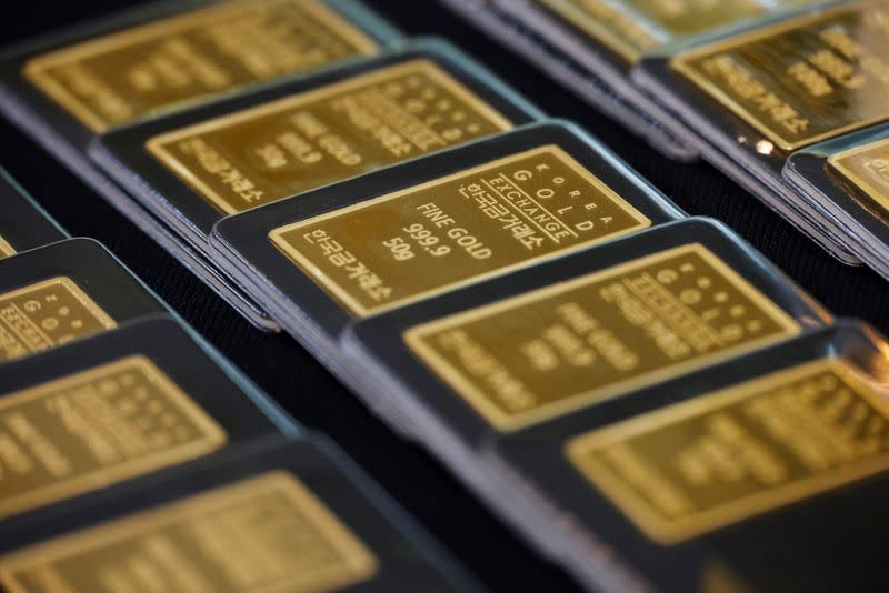 Gold hits near two-week high on dollar weakness, dovish Fed