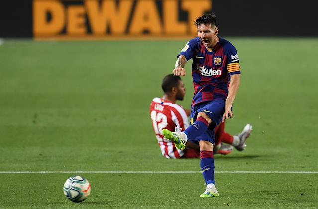 Lionel Messi's milestone 700th goal was not enough to help Barcelona beat Atletico Madrid and stem its slide. (Photo by David Ramos/Getty Images)