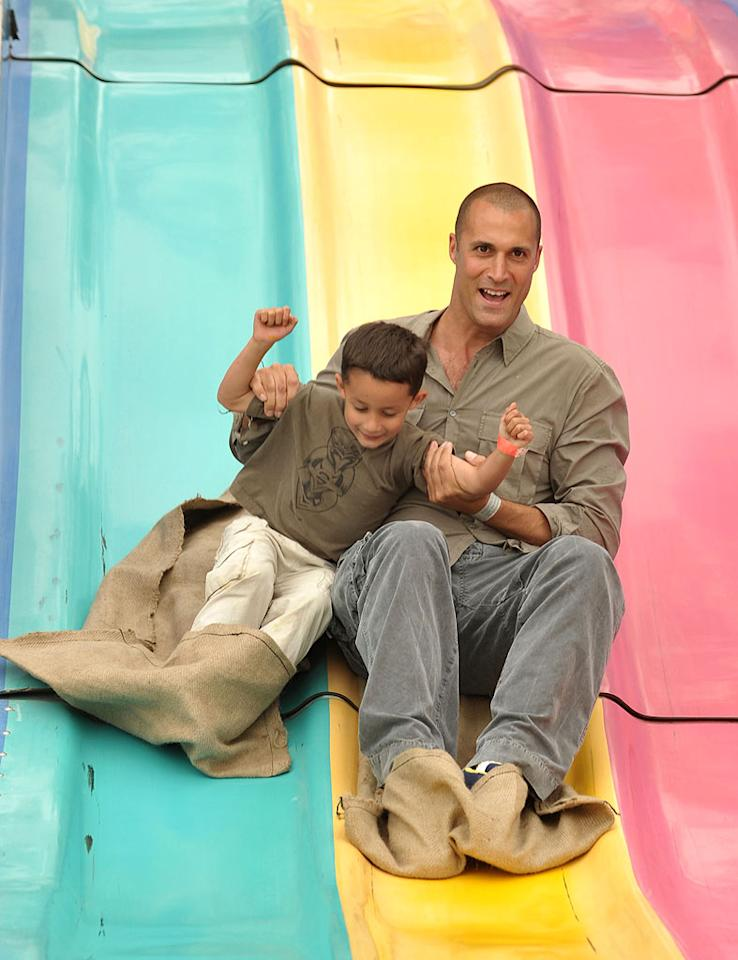 """Nigel Barker, of """"America's Next Top Model,"""" took a day off from judging to take his son, Jack, who turns 5 on November 28, for a ride. John Shearer/<a href=""""http://www.gettyimages.com/"""" target=""""new"""">GettyImages.com</a> - June 13, 2010"""