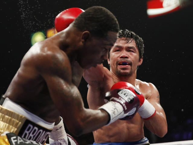 Manny Pacquiao, right, hits Adrien Broner during a WBA welterweight title boxing match Saturday, Jan. 19, 2019, in Las Vegas. (AP Photo/John Locher)