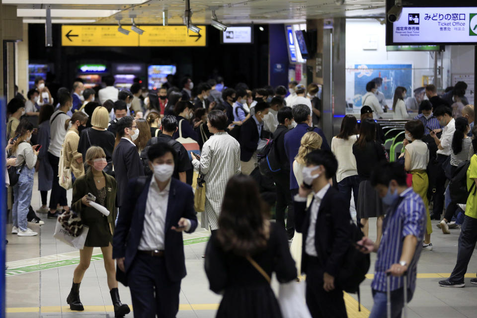 People wait at a train station in Tokyo early Friday, Oct. 8, 2021, after a powerful magnitude 5.9 earthquake has shaken the Tokyo area late Thursday, temporarily halting trains and subways. (AP Photo/Kiichiro Sato)
