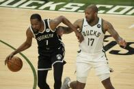 Brooklyn Nets' Kevin Durant tries to drive past Milwaukee Bucks' P.J. Tucker during the second half of Game 4 of the NBA Eastern Conference basketball semifinals game Sunday, June 13, 2021, in Milwaukee. (AP Photo/Morry Gash)