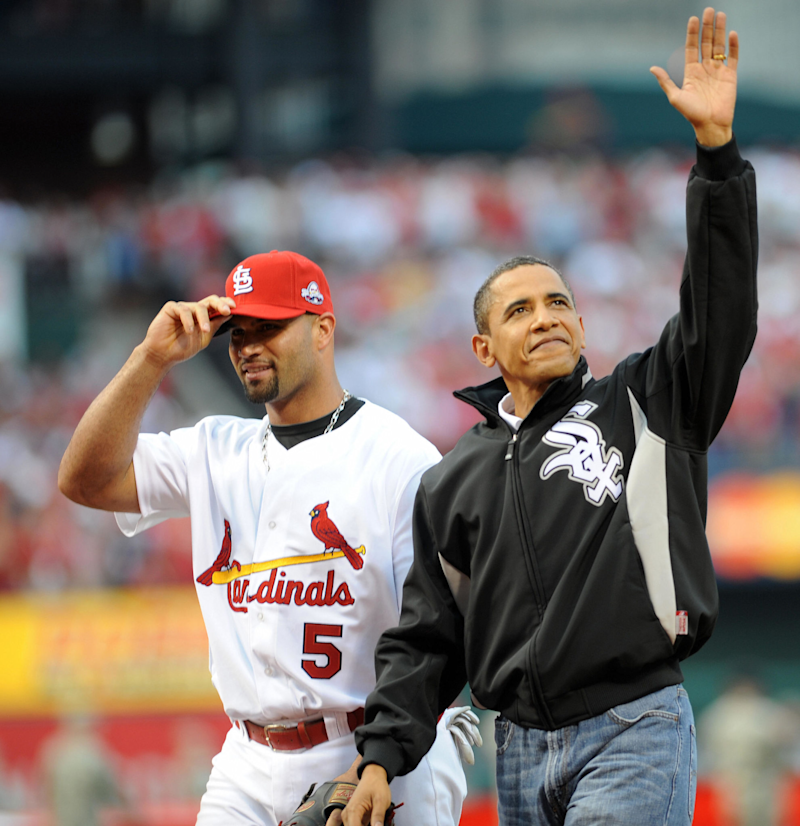 Barack Obama waves after throwing out the first pitch to Albert Pujols at the 2009 All-Star Game.
