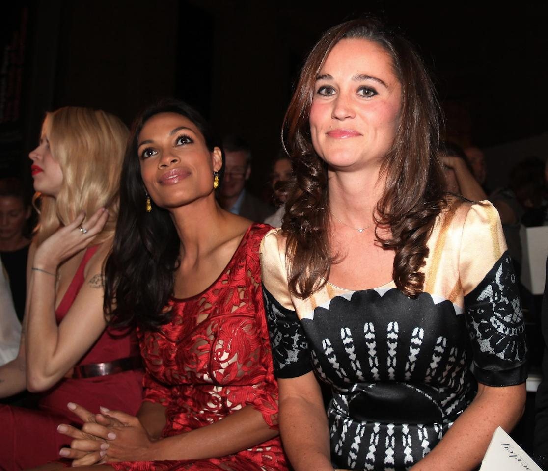 Members of the audience at a fashion show during The London Fashion Week, include Pippa Middleton, the sister of Britain's Kate, Duchess of Cambridge, right, with American actress Rosario Dawson, and Peaches Geldof, left, pictured during the Temperley London Spring/Summer 2012 fashion show held at the British Museum in London, Monday Sept. 19, 2011. (AP Photo / Katie Collins, PA) UNITED KINGDOM OUT - NO SALES - NO ARCHIVES