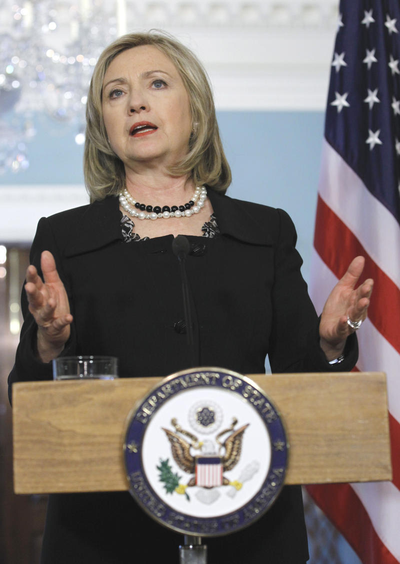 Secretary of State Hillary Rodham Clinton gestures while speaking at the State Department in Washington, Wednesday, April 20, 2011. (AP Photo/Alex Brandon)
