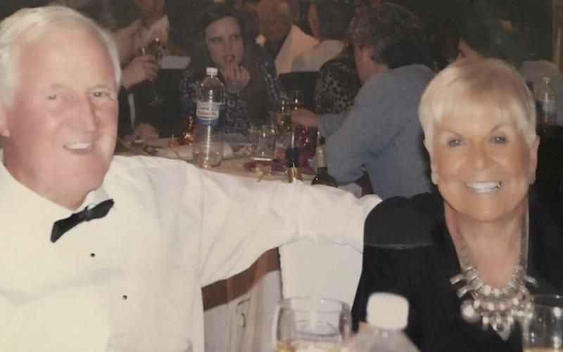 Robert Adamson, then 78, with wife Judith at a party around four years before his death - Rosie Taylor