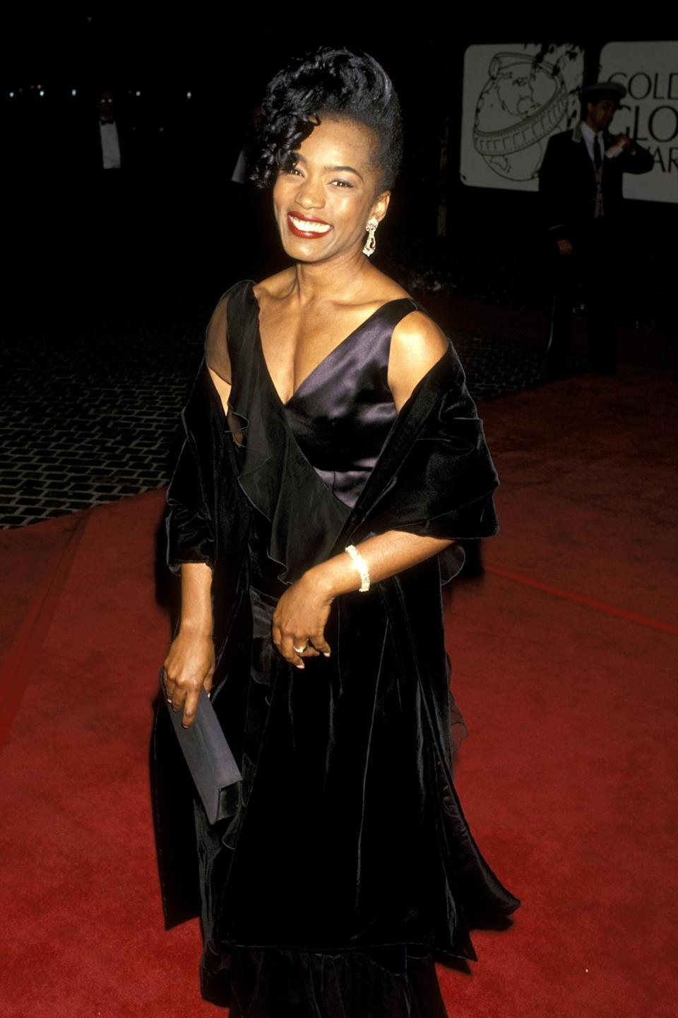 """<strong><h2>1994</h2></strong><br>Is it just us, or is Angela Bassett absolutely glowing in this all-black Golden Globes ensemble?<br><br><em>Angela Bassett in a black dress.</em><span class=""""copyright"""">Photo: Ron Galella/WireImage.</span>"""