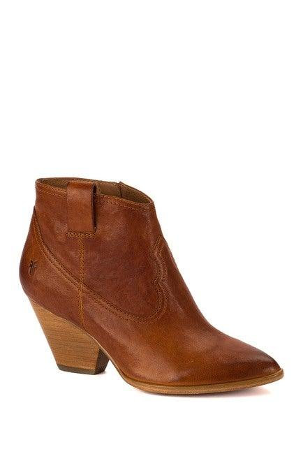 "<br><br><strong>Frye</strong> Reina Leather Bootie, $, available at <a href=""https://go.skimresources.com/?id=30283X879131&url=https%3A%2F%2Fwww.nordstromrack.com%2Fshop%2Fproduct%2F2299856%2Ffrye-reina-leather-bootie"" rel=""nofollow noopener"" target=""_blank"" data-ylk=""slk:Nordstrom Rack"" class=""link rapid-noclick-resp"">Nordstrom Rack</a>"