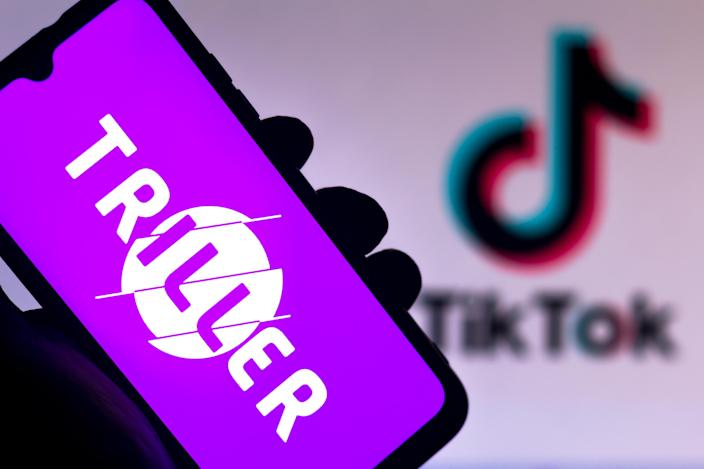 BRAZIL - 2020/08/17: In this photo illustration the Triller logo seen displayed on a smartphone with a TikTok logo in the background. (Photo Illustration by Rafael Henrique/SOPA Images/LightRocket via Getty Images)