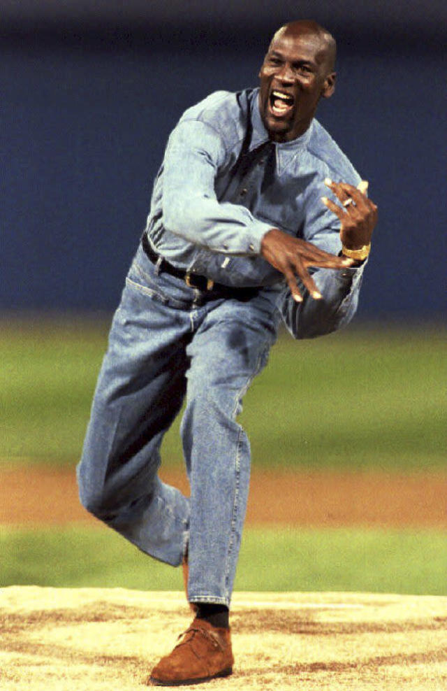 Michael Jordan throws out the first pitch at an American League Championship Series game between the Chicago White Sox and Toronto Blue Jays on Oct. 5, 1993, in Chicago, Illinois. (Photo credit should read CHRIS WILKINS/AFP via Getty Images)