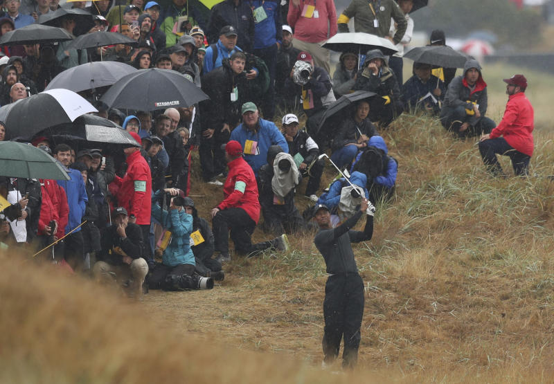 Tiger Woods of the US plays out of the rough on the 2nd hole during the second round of the British Open Golf Championship in Carnoustie Scotland Friday
