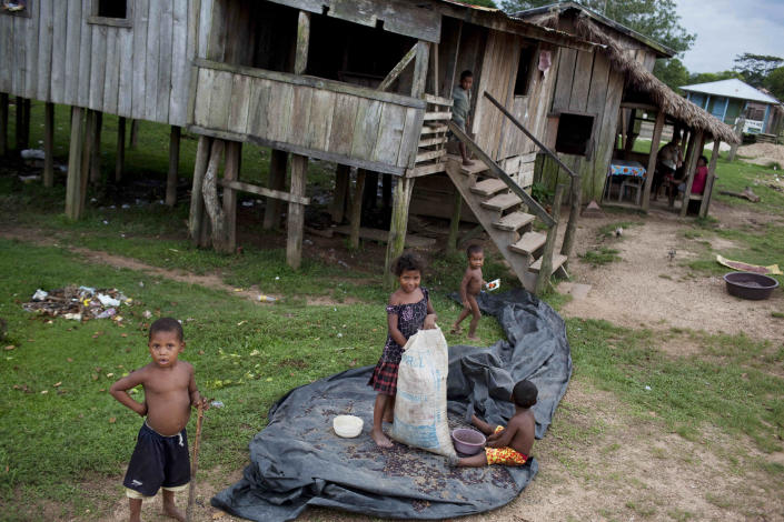 Children play outside their houses in the Paptalaya pier, where helicopters of a joint Honduran-U.S. drug raid landed last Friday, in Ahuas, Mosquitia region, Honduras, Monday, May 21, 2012. On Friday May 11, a helicopter mission with advisers from the DEA, appears to have mistakenly targeted civilians in the remote jungle area, killing four riverboat passengers and injuring four others. Later, according to villagers, Honduran police narcotics forces and men speaking English spent hours searching the small town of Ahuas for a suspected drug trafficker.(AP Photo/Rodrigo Abd)