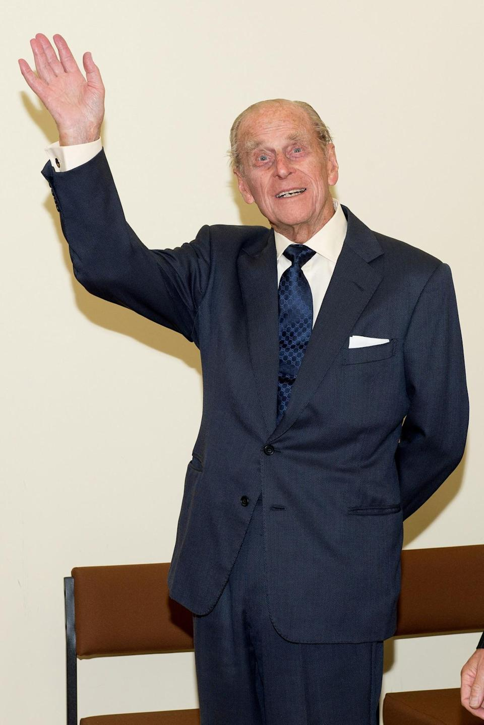 <p>The Duke of Edinburgh, waves during his official visit to the St Michael's Care Complex in Aylsham, Norfolk, which provides care for the elderly. </p>