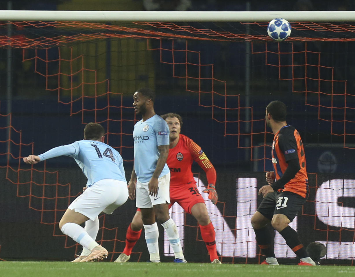 Manchester City Aymeric Laporte, left, scores his side's opening goal during the Group F Champions League soccer match between FC Shakhtar Donetsk and Manchester City at the Metalist Stadium in Kharkiv, Ukraine, Tuesday, Oct. 23, 2018. (AP Photo/Efrem Lukatsky)
