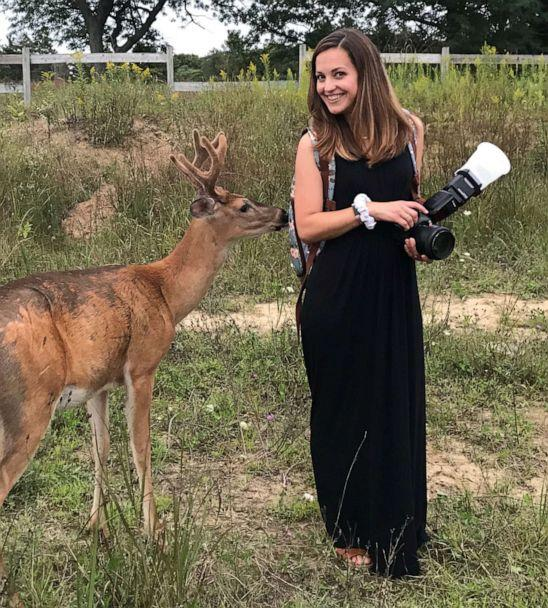 PHOTO: Photographer Laurenda Marie poses next to the deer that surprised her while she was taking wedding photos for the Mackleys. (Laurenda Marie Photography)