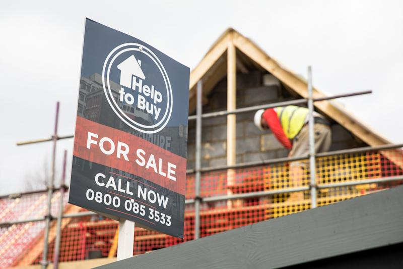 A sign advertising a property for sale under the governments Help To Buy scheme stands next to a building site in London, U.K. on Tuesday, March 26, 2019. With Britain's future outside of the EU still as unclear as ever, the London property market is taking the biggest hit. Photographer: Chris Ratcliffe/Bloomberg via Getty Images
