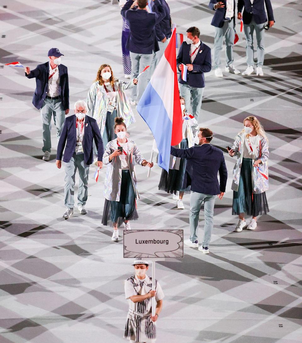 <p>Luxembourg rocked metallic jackets over their uniforms. </p>