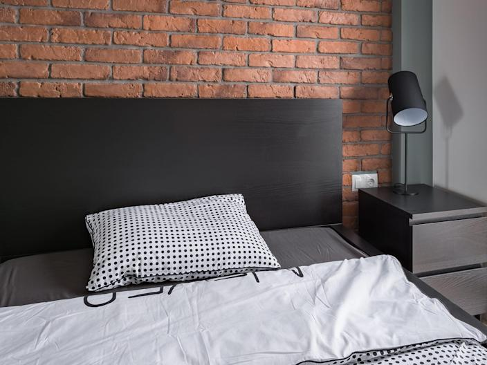 industrial style bedroom with brick
