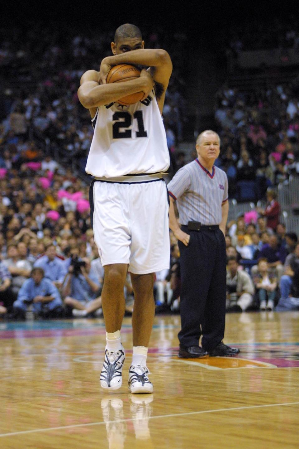 <p>2001: Tim Duncan #21 of the San Antonio Spurs during game two of round one of the NBA playoffs against the Minnesota Timberwolves at the Alamodome in San Antonio, Texas. The Spurs won 86-69. DIGITAL IMAGE. Mandatory Credit: Ronald Martinez/Allsport<br></p>