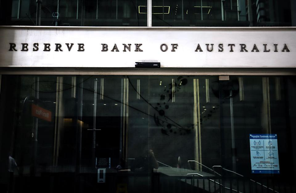 A sign is displayed on a door at an entrance to the Reserve Bank of Australia (RBA) building, during a partial lockdown imposed due to the coronavirus, in Sydney, Australia, on Monday, May 18, 2020. Australia. (Photographer: David Gray/Bloomberg via Getty)