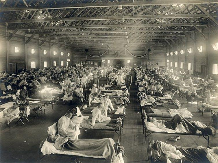 A hall of influenza patients in bed.
