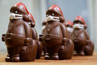 Chocolate Santas wearing protective face masks are seen in the workshop of the Hungarian confectioner Rimoczi in Lajosmizse