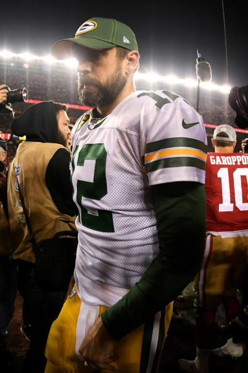 Green Bay great Aaron Rodgers walks off the field after the Packers came up short in the NFL's NFC Championship game against the San Francisco 49ers (AFP Photo/Harry How)