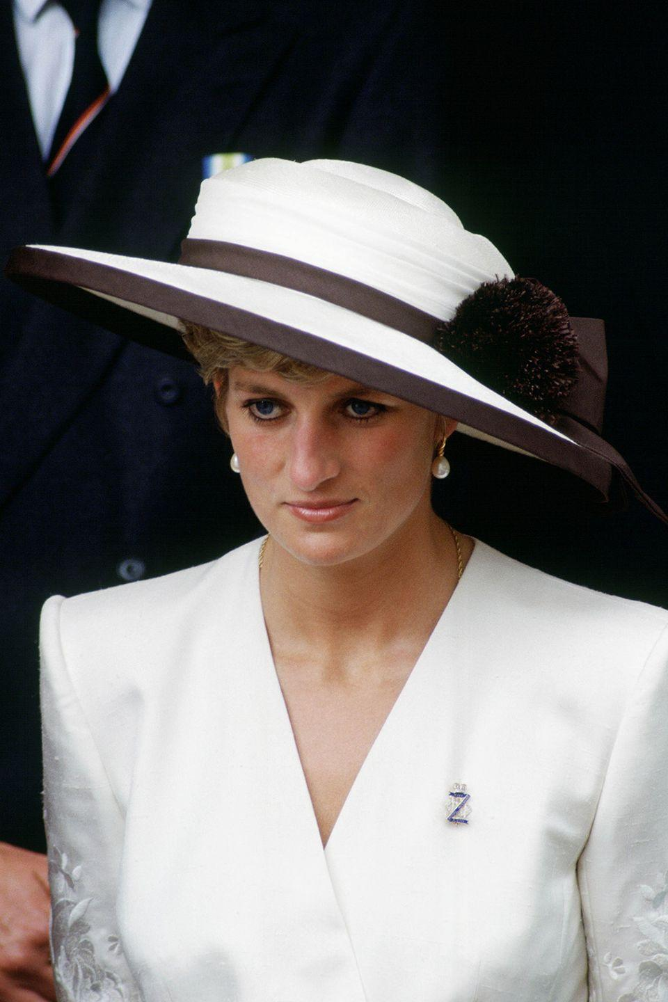 <p>Wearing a brown-and-white hat designed by Marina Killery at an event in London. </p>