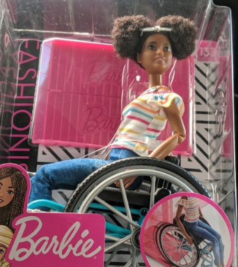 Barbie's new collection includes a black doll in a wheelchair, wearing natural hair (Credit: Twitter)