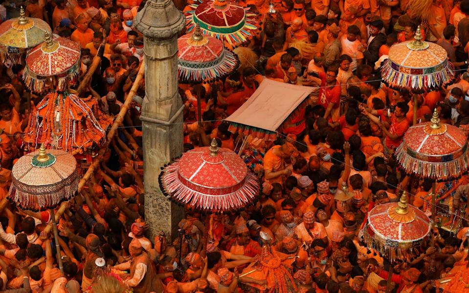 There was not much in the way of social distancing at the Sindoor Jatra vermillion powder festival in Bhaktapur, Nepal, this week - Reuters