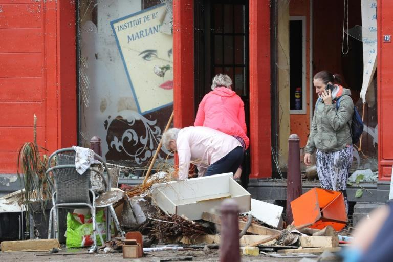 Residents assessed the damage in Belgium, where more than 21,000 people had no electricity in one area