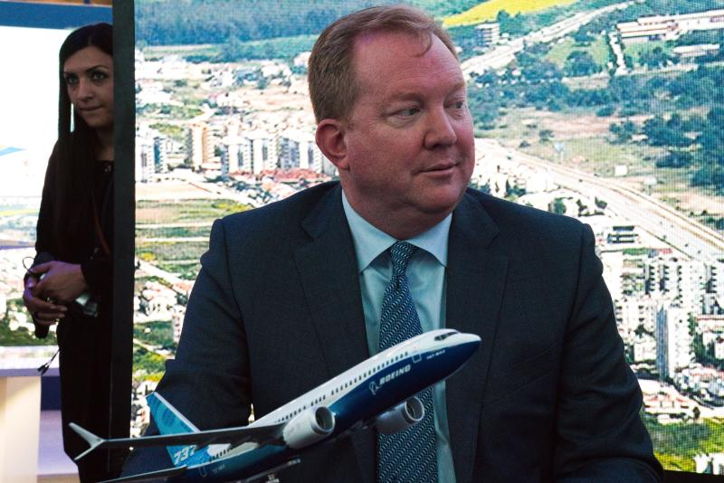 Boeing Commercial Airplanes president and CEO Stanley A. Deal sits in front of a model of a Boeing 737 Max at a news conference during the Dubai Airshow in Dubai, United Arab Emirates, Monday, Nov. 18, 2019. The Turkish-German airline SunExpress announced Monday it will be buying 10 of the troubled Boeing 737-8 Max jets, grounded globally after crashes, in a deal worth $1.2 billion. (AP Photo/Jon Gambrell)