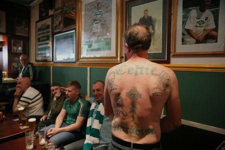 A Celtic fan shows off his tattoos in Bar' 67 after the last match of the season against Heart of Midlothian, Glasgow, Scotland, Britain, May 21, 2017. Picture taken May 21, 2017 REUTERS/Paul Hackett