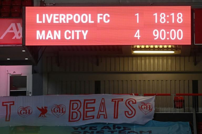 Manchester City beat Liverpool 4-1 at Anfield to move 10 points clear of the champions