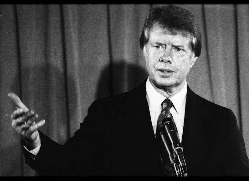 President Jimmy Carter pushes a mandatory national health plan, but economic recession helps push it aside.